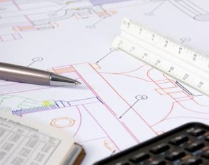 Engineering Drawings and tools on a table