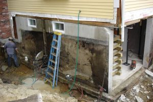 Exposing the foundation to repair cracks