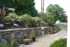 Important considerations in retaining wall design include height and length, suitable foundation, backfill and proper drainage
